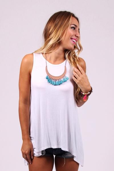 Stockholm white tank - The Stockholm White Tank is one of our favorite not-so-basic tanks! With a high neck and a high-low bottom, it looks cute on its own with