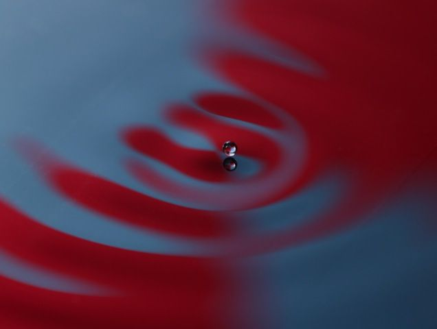 Fluid Tests Hint at Concrete Quantum Reality A droplet bouncing on the surface of a liquid has been found to exhibit many quantum-like properties, including double-slit interference, tunneling and energy quantization.