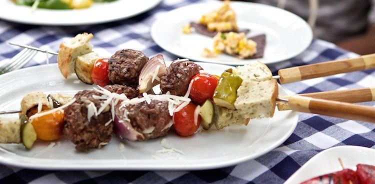 Deconstructed components—toasted bread, warm pickles, onion, and tomato—jazz up cubes of provolone-smothered ground beef in these burger kebabs