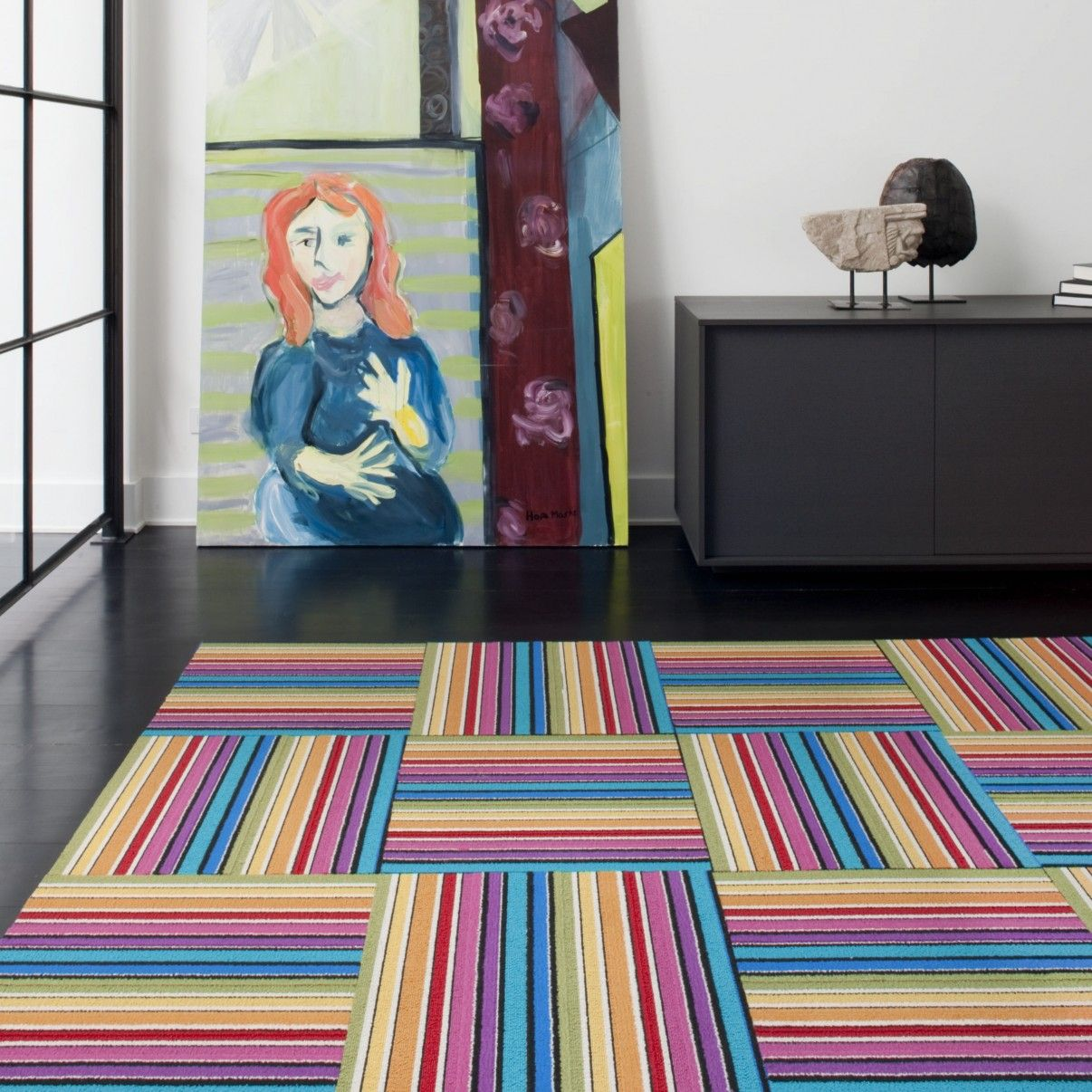 Rainbow carpet tiles--great idea for playroom. If one gets damaged you can