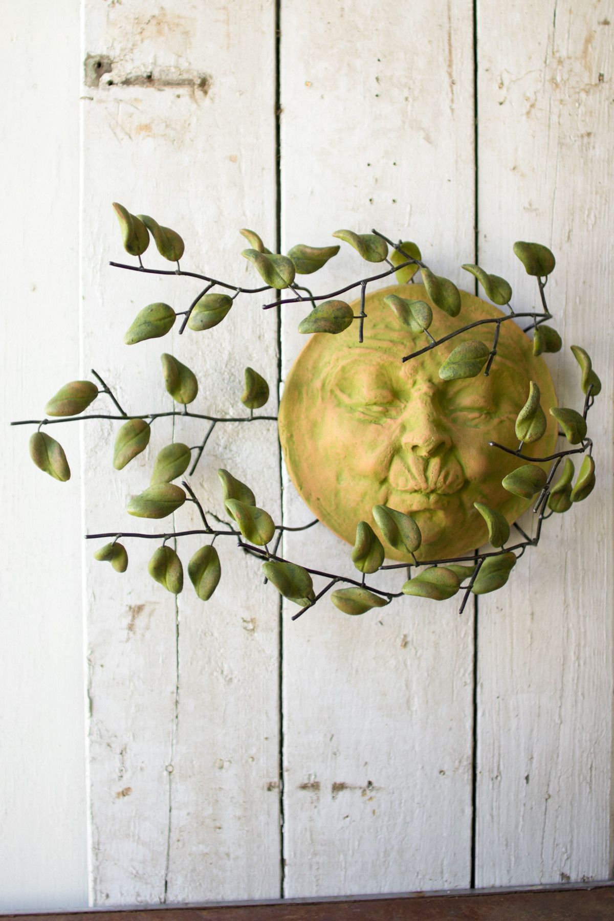 Kalalou wind blown sun face with clay leaves wall hanging