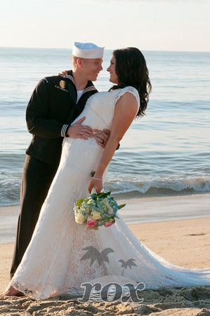Navy Groom Embraces Barefoot Beach Bride After Military Wedding Ceremony By Rox Weddings Of Ocean