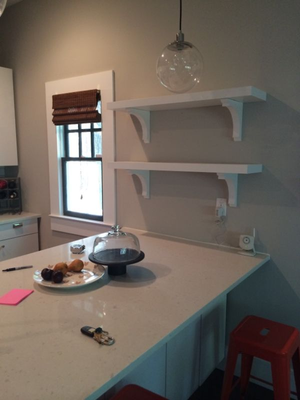 ikea painted lack shelves with corbels from home depot. tried and