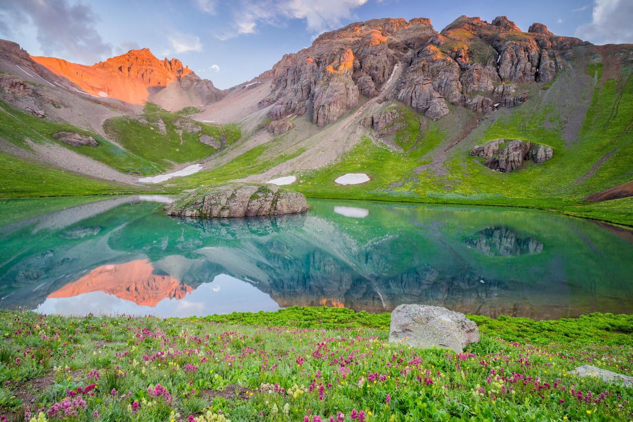 Early Morning Light Over A Field Of Wildflowers And Crystal Blue Lake In The San Juan Mountains Colorado San Juan Mountains Colorado Sunrise Lake Island Lake