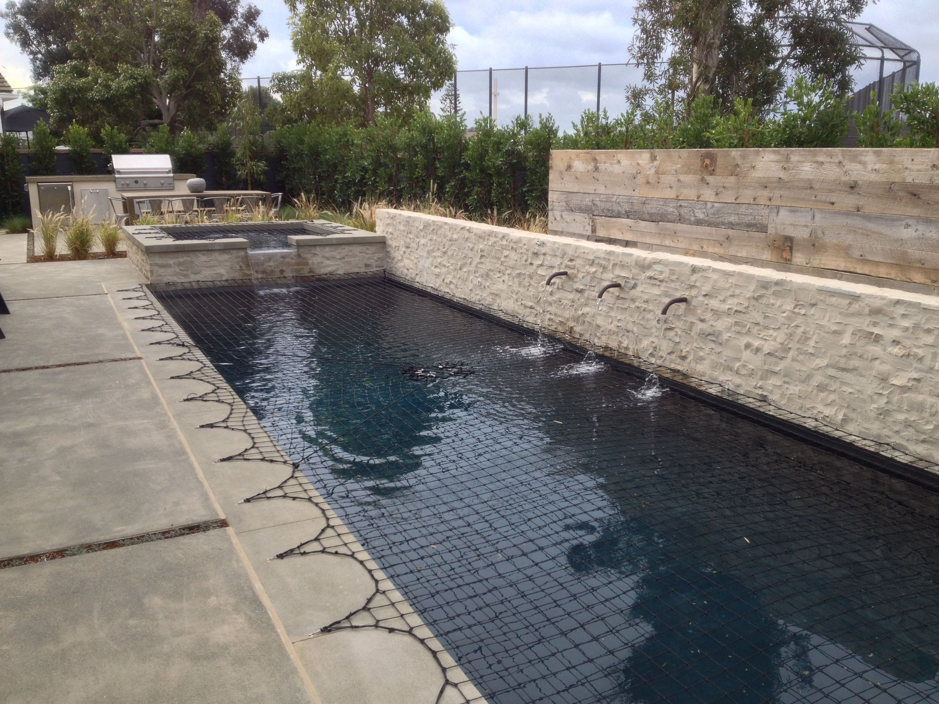 Pool With Smooth Sand Finish Colored Concrete Coping A