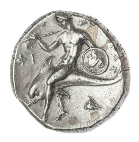 old coin with horse and rider