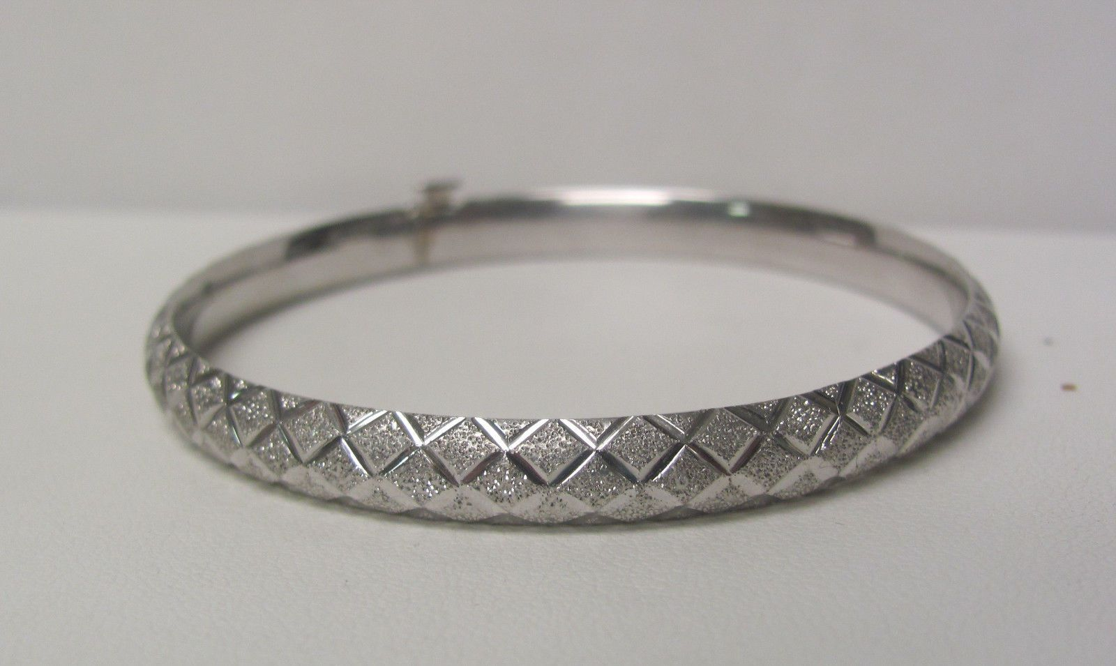 K white gold multi finish etched geometric design hinged bangle