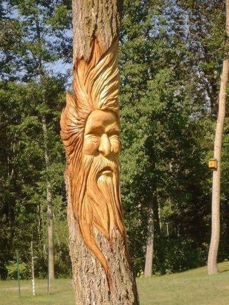 Tree carvings faces carving each one is