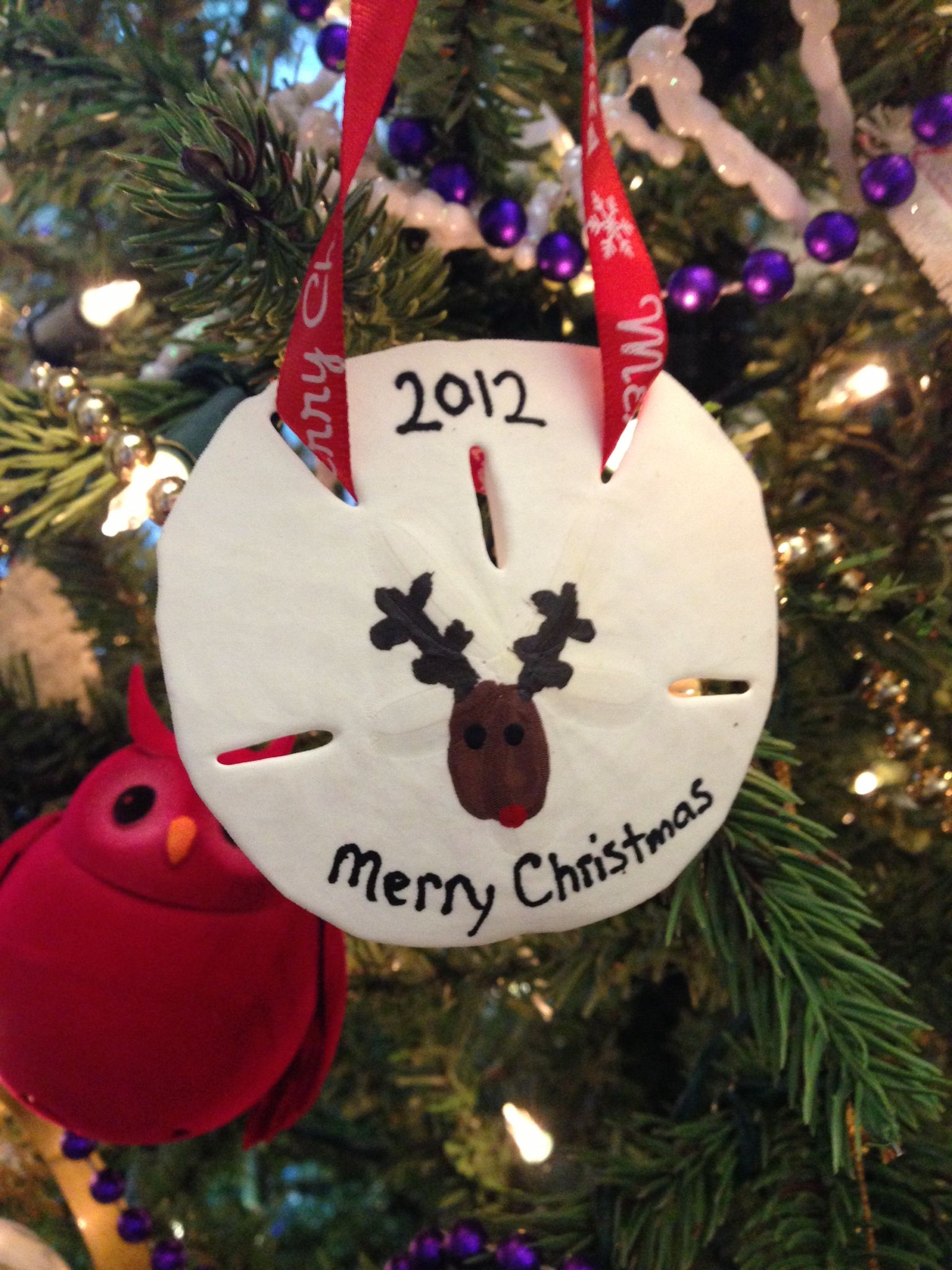 Reindeer Thumb Print on Sand Dollar Ornament Sand dollar