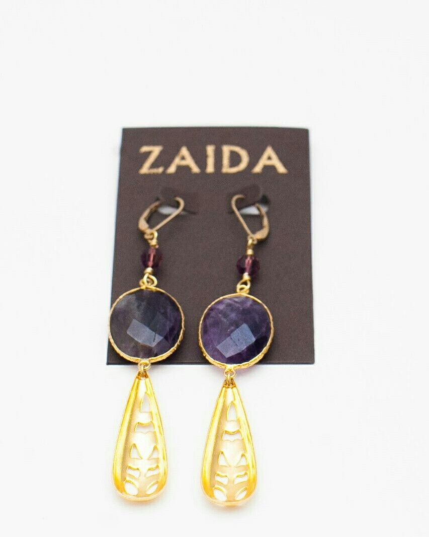 More items available for you. These earrings could be yours. Ask us for them or look for them in our trunkshow next month
