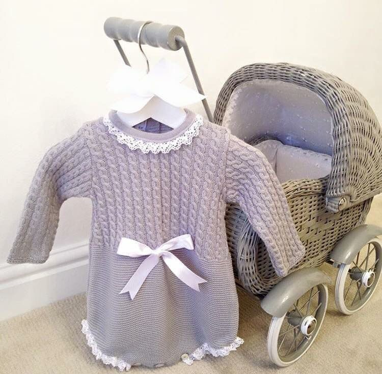 For the little dolly in your life 'Esme', cutest Spanish grey knit romper with satin bow and white lace edge finishes.  Purchase this and more from our baby boutique at bellaandlucella.com
