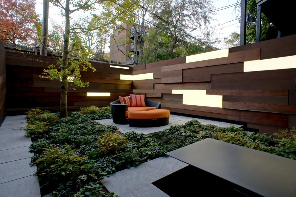 small private city garden  wood fence with light panels  geometric shapes  concrete patio