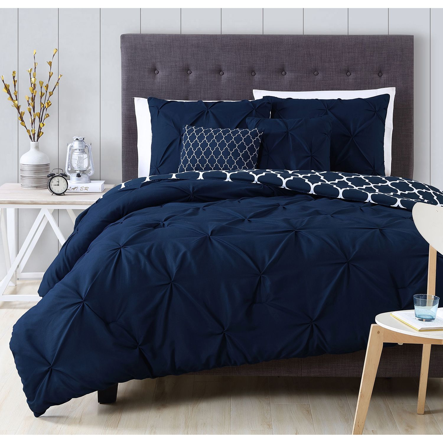 A beautiful pintuck design adorns a charcoal white blue for Blue and taupe bedroom ideas