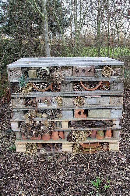 Photo of Back garden Bug Hotel out of pallets, brick post and garden bric-a-brac