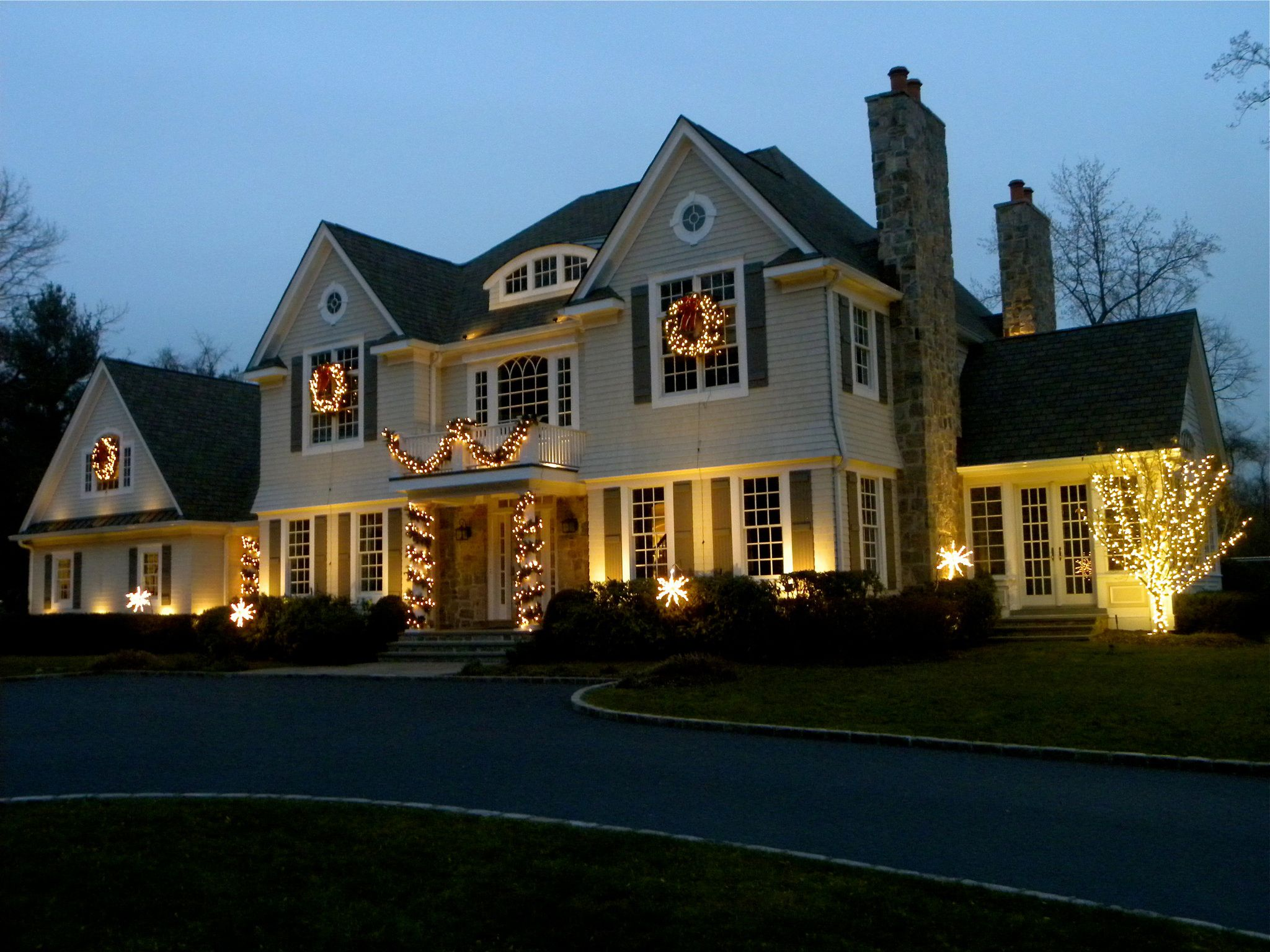 holiday lighting that professional outdoor lighting experts design and install take all the hassle out of