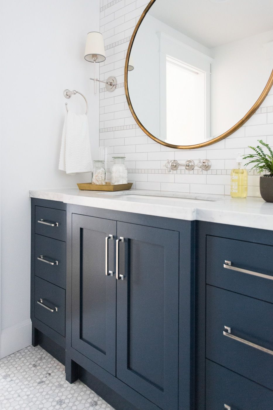 blue bathroom vanity cabinet. Marble mosaic floor and navy cabinets  Studio McGee Windsong Tour Basement pt 1 Navy mcgee