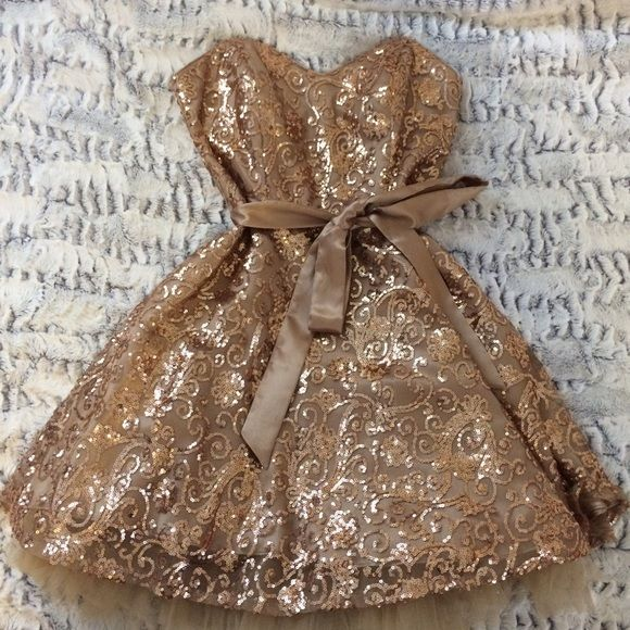 GOLD SEQUIN FORMAL DRSSS Gold formal dress with sequin detailing all over. Fit and flare style with bow around the waist. Wore once to a homecoming dance, in great condition! Would be great for prom! Dresses Prom