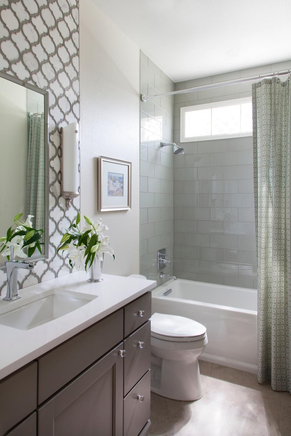 This Small Guest Bathroom Packs In A Lot Of Style With A Fully - Guest bathroom tile ideas