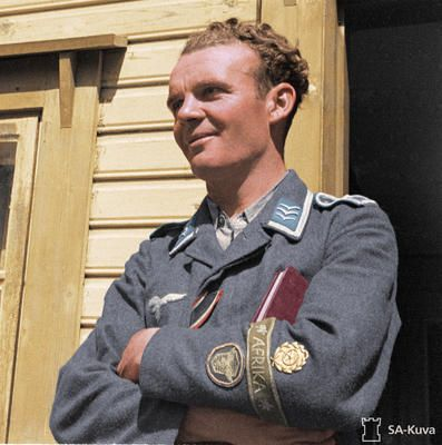 "Veteran Luftwaffe driver - ""Decorated driver, feldwebel Nill. He is wearing  ribbon of the War Merit Cross. On his sleeve he has… 