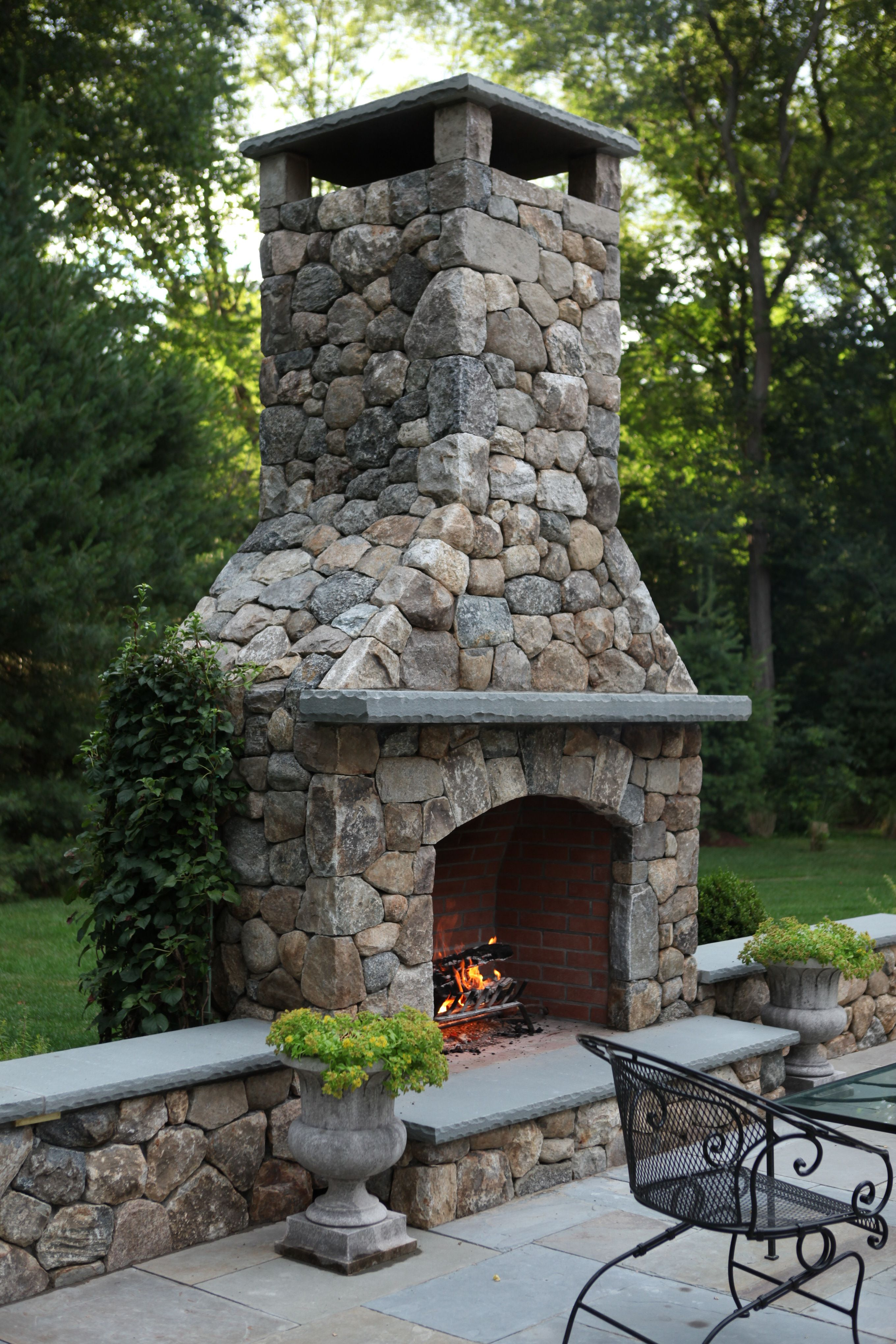 Outdoor fireplace built by freddyus landscape company project