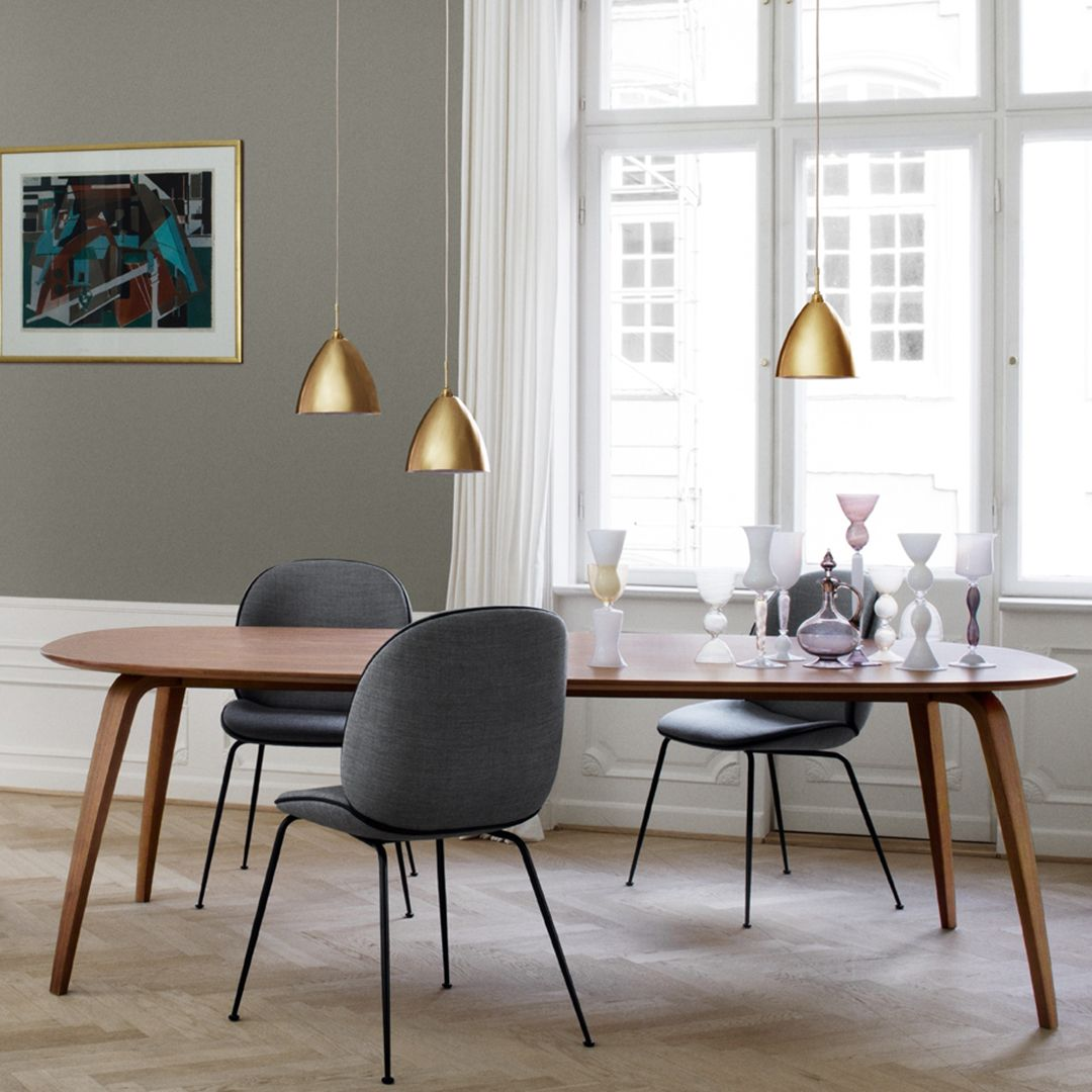 A Traditional Scandinavian Design Aesthetics With A Wood Base Matching The Table Top Elliptical Gubi Dining Table Dining Room Design Gubi Beetle Dining Chair