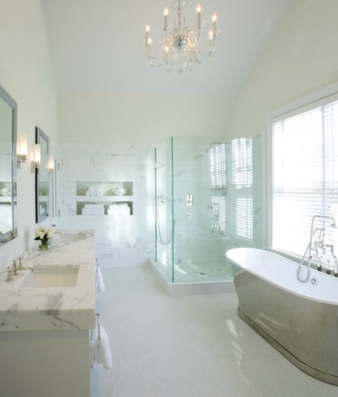 Chic, elegant ensuite design with Waterworks Candide Tub, ivory walls paint  color, seamless glass shower with marble shower surround, white double  bathroom ...