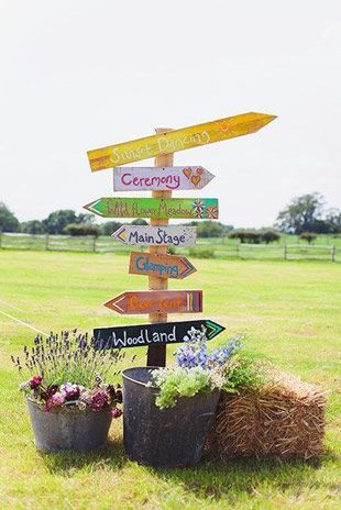 Festival Wedding Signage - Read more on One Fab Day: http://onefabday.com/festival-style-wedding-ideas/