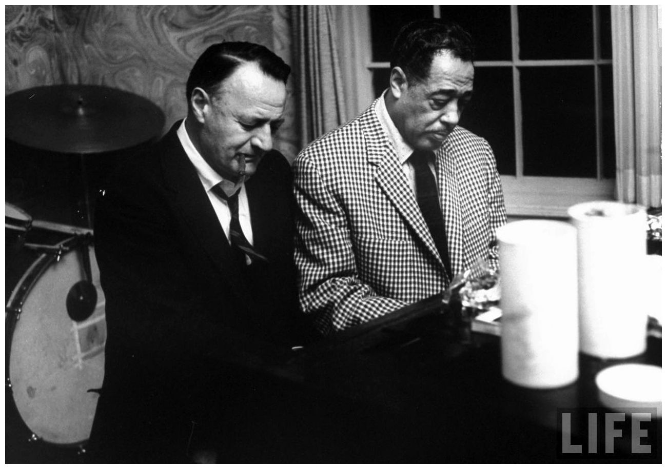 Author John D. Voelker (L) and Duke Ellington playing the piano on ...
