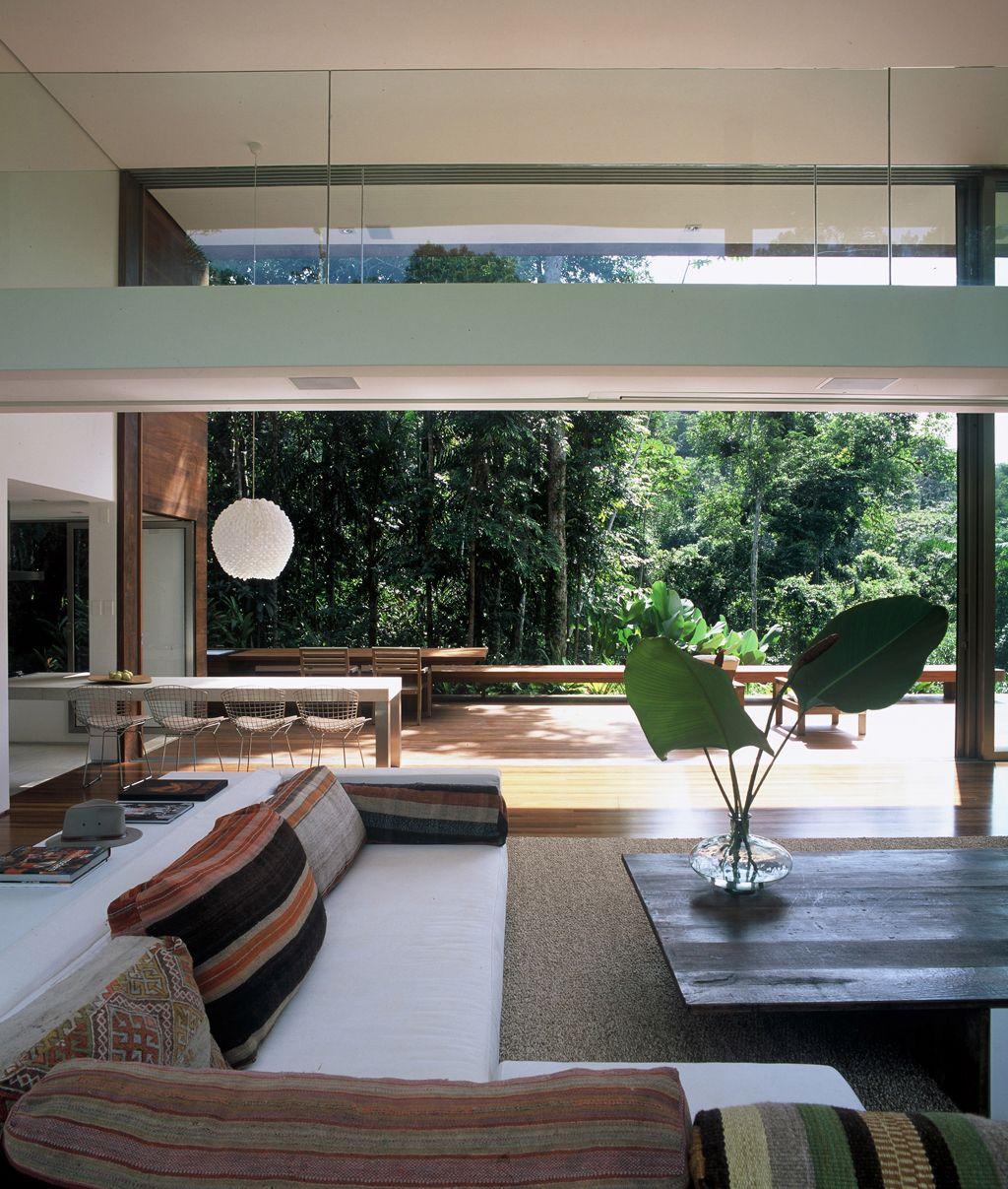 AC Iporanga / Studio Arthur Casas #living #dining #patio #yard #green #view