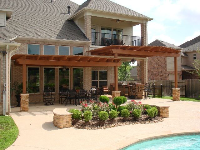This Covered Outdoor Kitchen, Bar, Grill And Dining Area   Framed By A  Custom