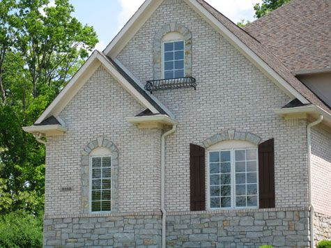 Custom Home, White Brick Exterior, Decorative Stone Apron / Window Trim,  Shutters;