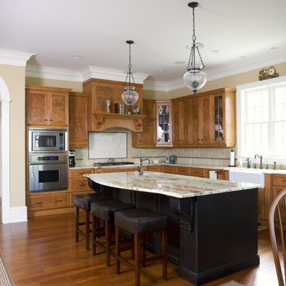 Stained Cabinets With Black Island