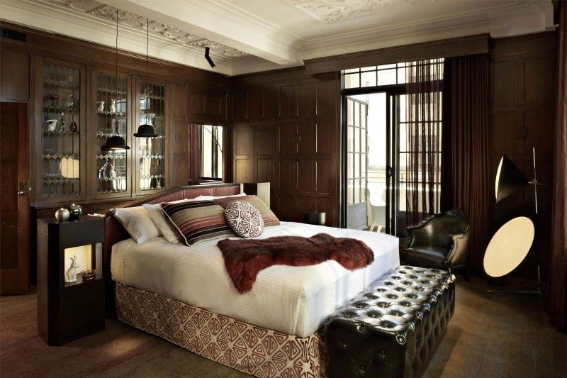 Guest room at the QT Sydney Hotel designed by Woodhead, Indyk Architects, and Nicholas Graham + Associates