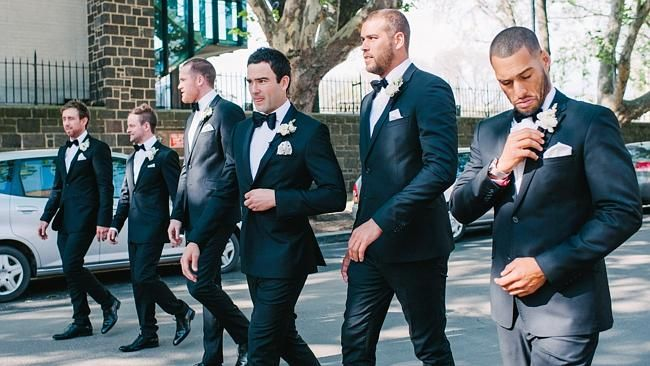 Jordan Lewis arrives at St Thomas Aquinas Church for his wedding with teammates Jarryd Ro