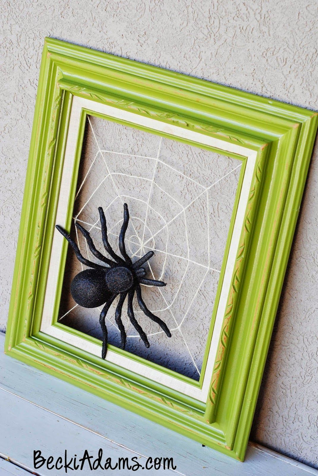 50 spooky fun and cute diy halloween decorations spider webs tutorial included for this halloween spider web frame decoration jeuxipadfo Choice Image