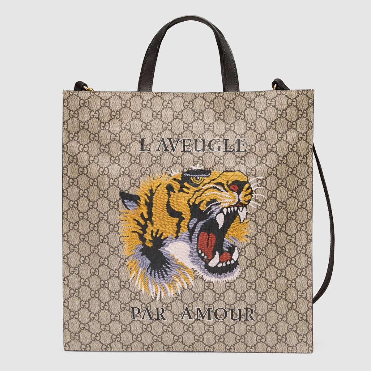 b5cfbf16f231 GUCCI Tiger Print Soft Gg Supreme Tote - Tiger Print. #gucci #bags #canvas # tote #leather #lining #shoulder bags #linen #hand bags #cotton #