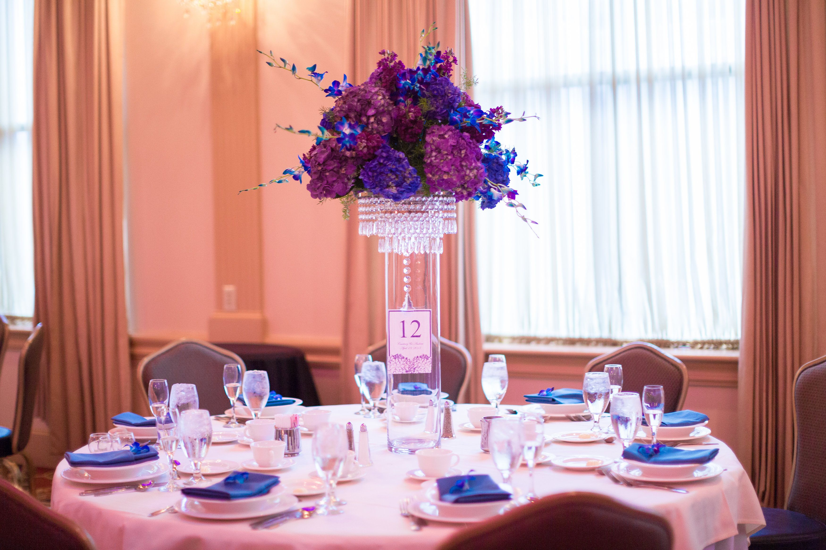 The centerpieces featured blue and purple hydrangea, purple stock ...