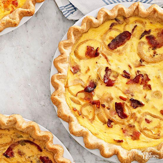 Tantalize taste buds of holiday guests with the enticing flavors of this quiche Lorraine recipe. A flaky piecrust holds all your breakfast favorites: cheese, eggs, and savory bacon. /