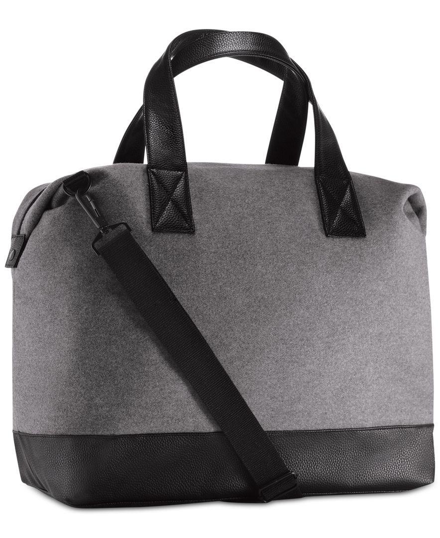 Receive a Complimentary Duffel Bag with a 3.3 oz Eau de Toilette or Eau de Parfum purchase from the Yves Saint Laurent Men's Fragrance Collection