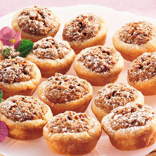Preheat the oven to degrees F. In a large mixing bowl, mix the brown sugar, granulated sugar and eggs until creamy. Add the chopped pecans, melted butter, milk, flour and vanilla.