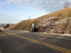 Taylor Man Escapes Injury in Leelanau County Roll-over Accident