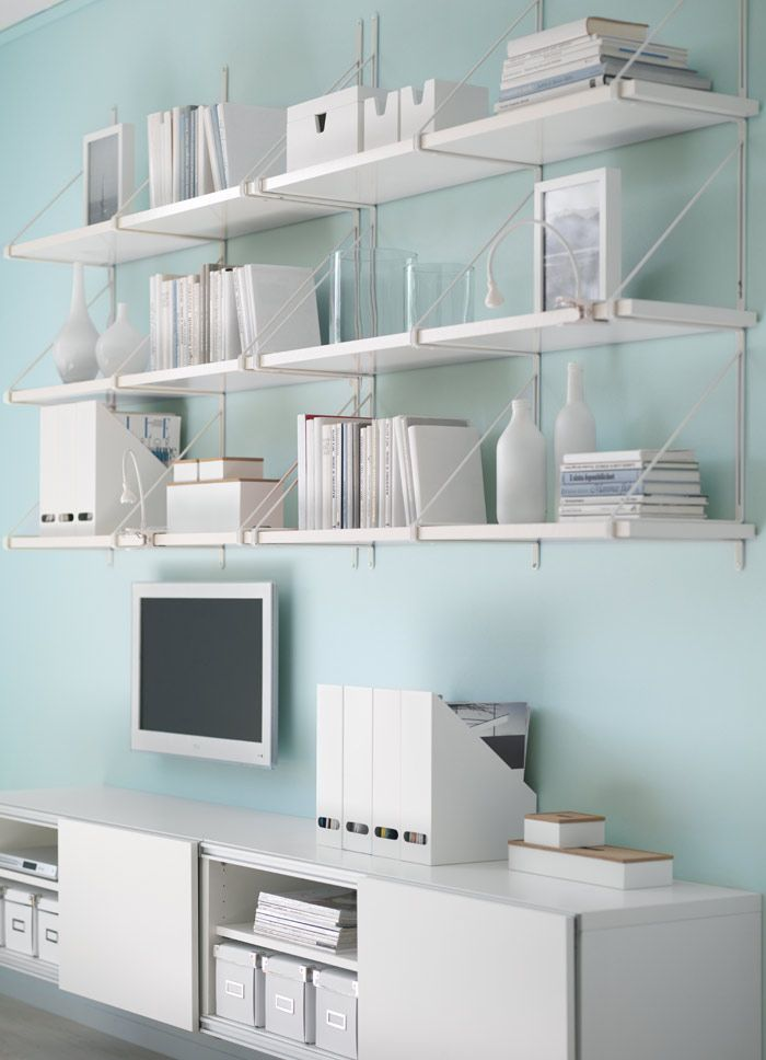 BESTÅ storage combination with sliding doors and EKBY JÄRPEN/EKBY GÄLLÖ wall shelves all in white
