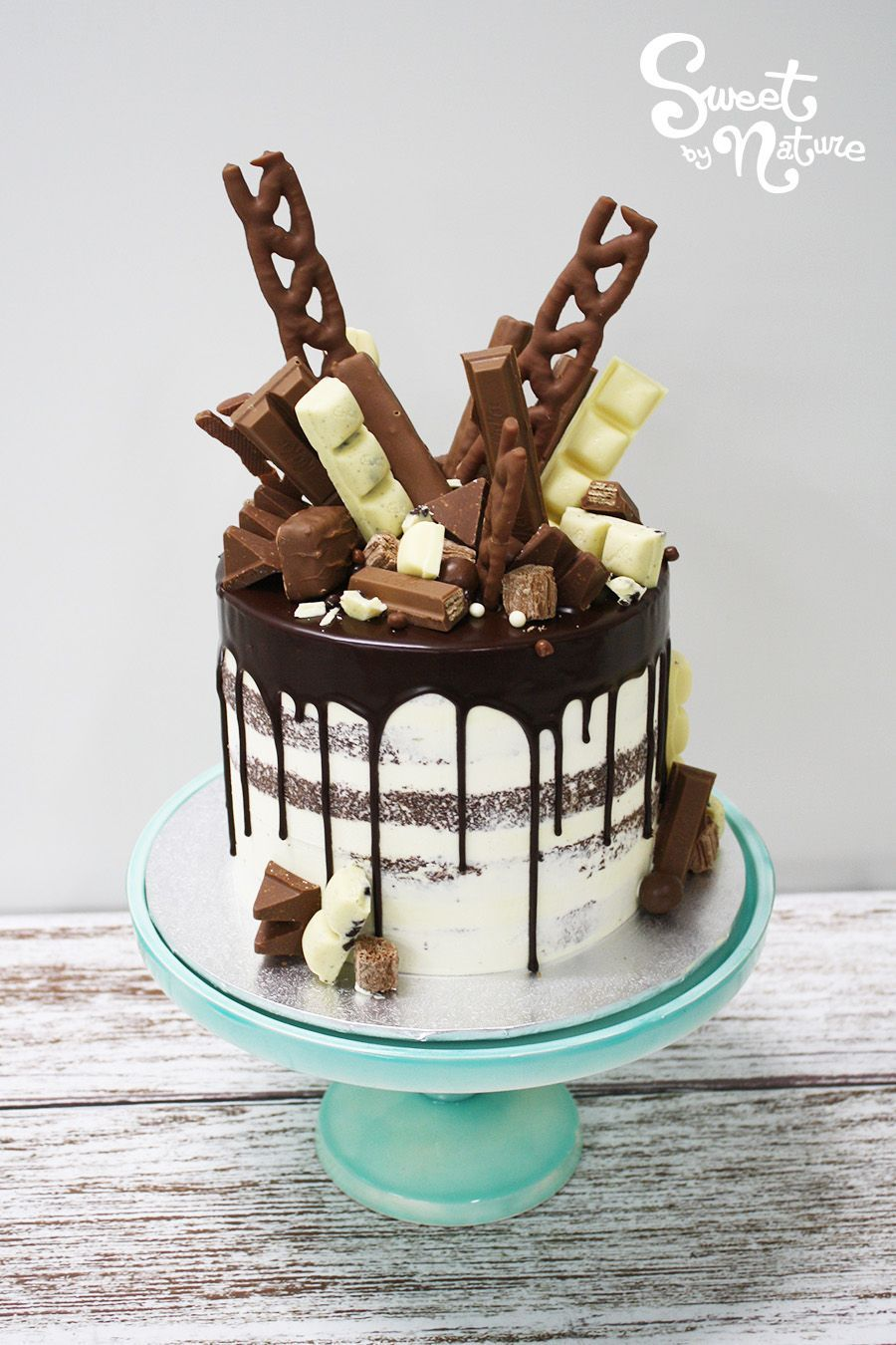 Chocolate Lovers Rejoice Semi Naked Birthday Cake Topped With On