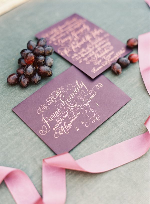 Beautiful gold calligraphy on burgundy envelopes - this would be great for a vineyard wedding - Adam Barnes Photography