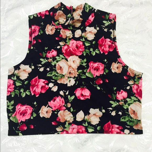 High neck black and pink floral crop top NWOT. Somewhat Stretchy material.. :) Love j Tops Crop Tops