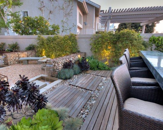 terrasse garten holz kies gabionen bambuspflanzen essmöbel rattan ...