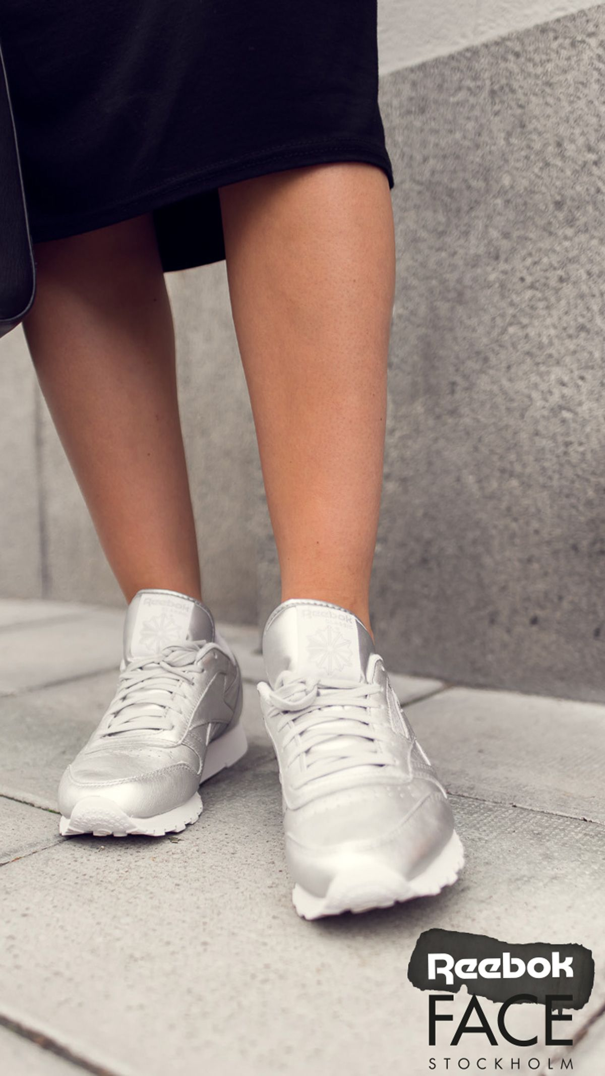 Swedish blogger Lisa Olsson flaunts her strong sneaker game in these silver Reebok X Face Stockholm Classic Leather shoes. #BoldFinishes