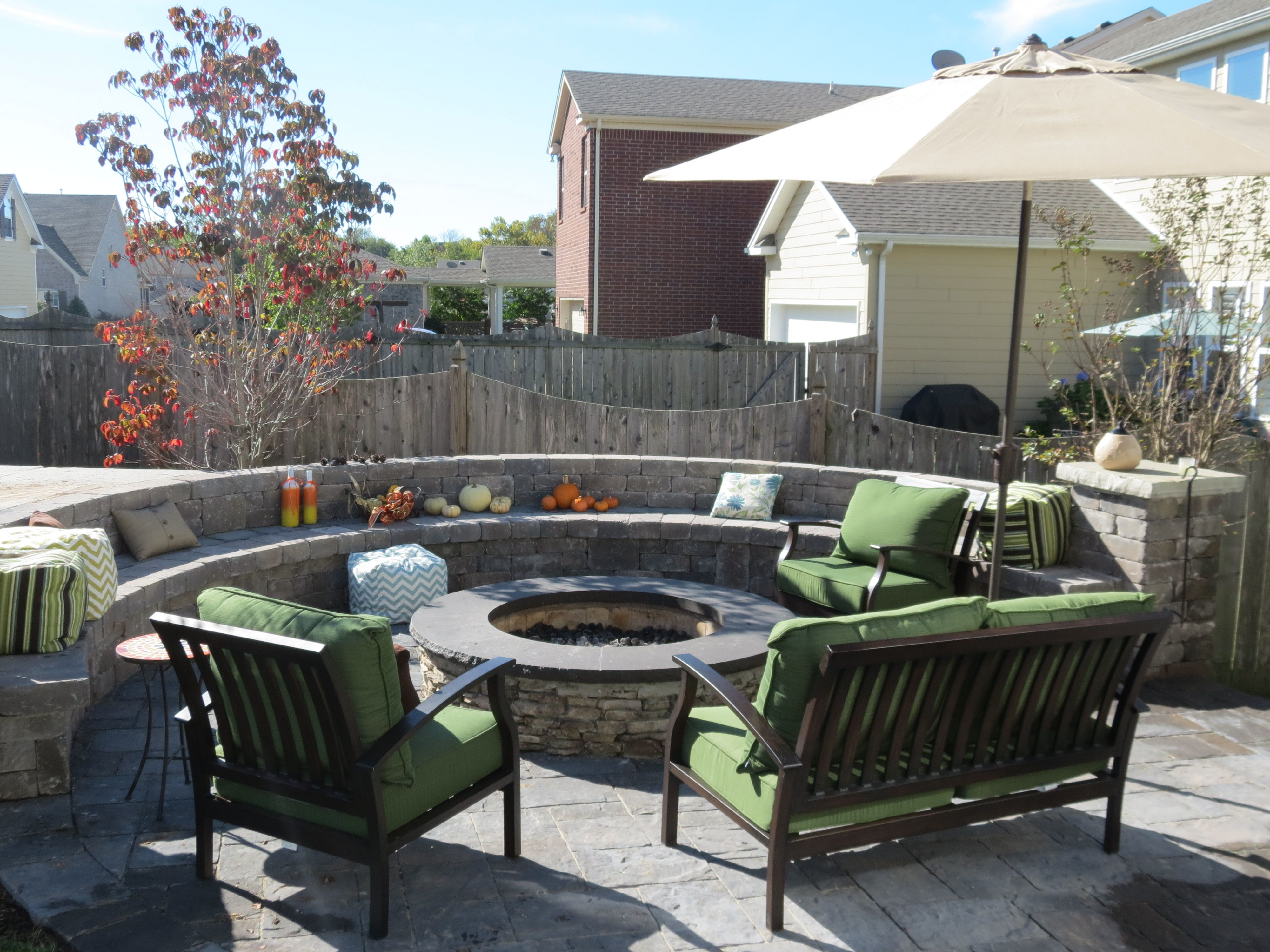 Backyard Brick Paver Patio With Natural Stone Fire Pit And