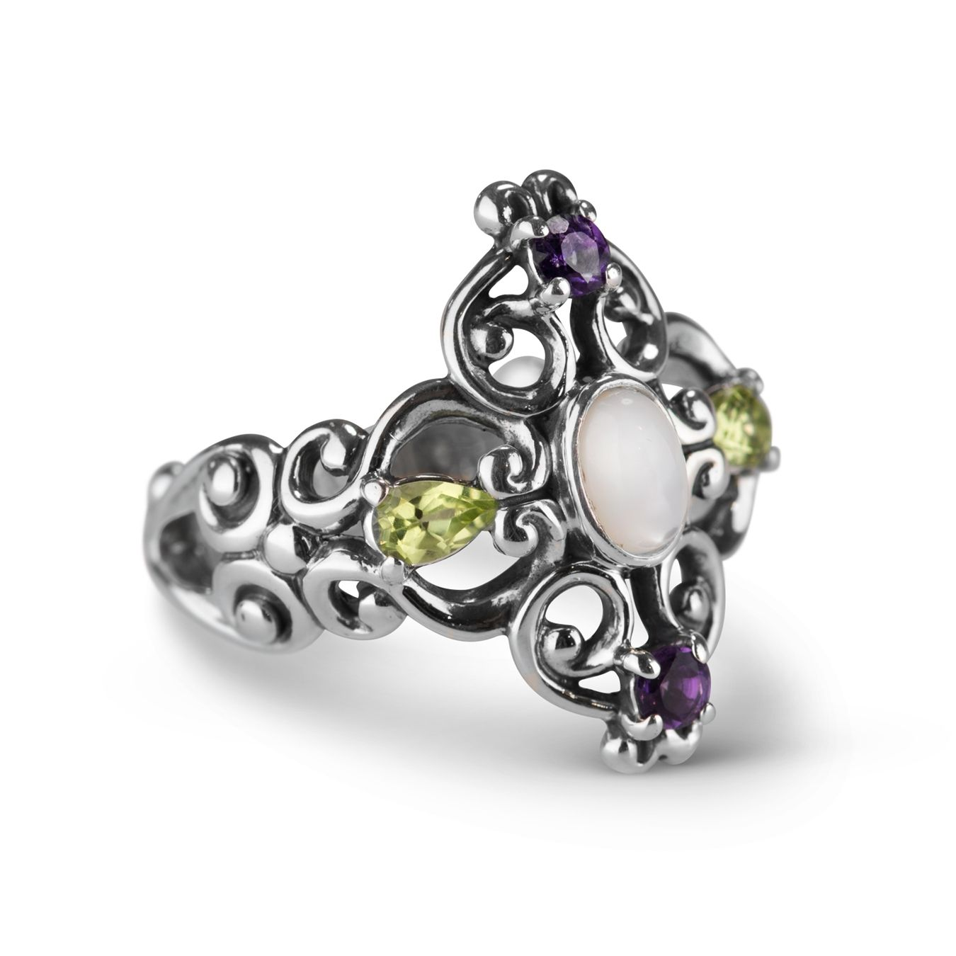 • Sterling silver bold ring• Amethyst, peridot and white mother of pearl gemstones• Measures approximately 1 wide x 1 long• Designed and crafted in America with gemstones from around the worldExquisite in color and graceful in its filigree design this multi gemstone flower ring has a charm all its own.  Faceted gemstones of amethyst and peridot are prong set into the sterling silver filigree design and a white mother of pearl glimmers at its center.  A ring with striking color that brightens…