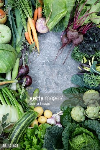 Stock Photo : Various vegetables against concrete background
